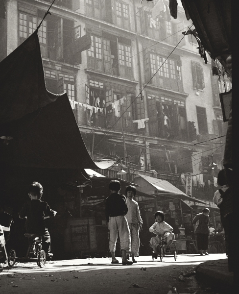 Fan-Ho-Age-of-Innocence-in-Sheung-Wan-童趣-Hong-Kong-1950s-and-60s-courtesy-of-Blue-Lotus-Gallery.jpg